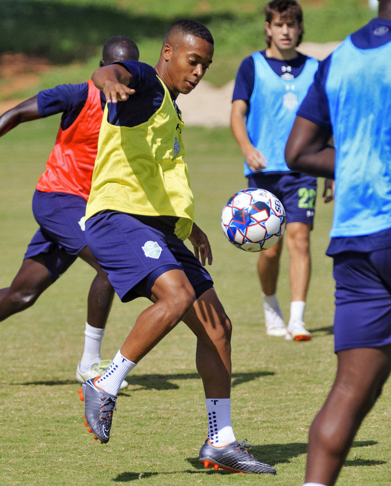 Photo -  Josh Garcia, left, midfielder for the Energy FC's U-23 team runs through drills as he practices with the team in Oklahoma City, Okla. on Tuesday, July 3, 2018. Photo by Chris Landsberger, The Oklahoman