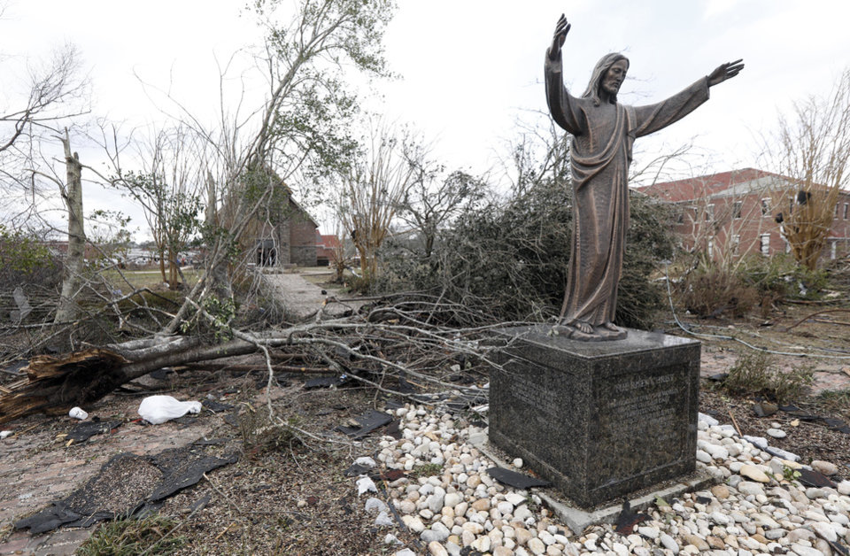 Damaged Bushes, Brush And Tree Limbs Surround The Statue Of Jesus Christ In  The Chain