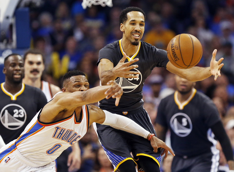Photo - Golden State's Shaun Livingston (34) and Oklahoma City's Russell Westbrook (0) chase the ball during an NBA basketball game between the Oklahoma City Thunder and the Golden State Warriors at Chesapeake Energy Arena in Oklahoma City, Saturday, Feb. 27, 2016. Golden State won 121-118 in overtime. Photo by Nate Billings, The Oklahoman