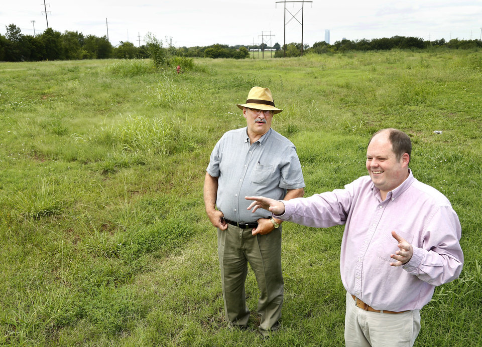 Photo -  City Manager Mark Edwards, left, and Tom Leatherbee, director of Del City's Community Services, talk about their deal with Hunt Properties Inc. to redevelop about 19 acres on the south side of Interstate 40 at Scott Street. [Photo by Jim Beckel, The Oklahoman]