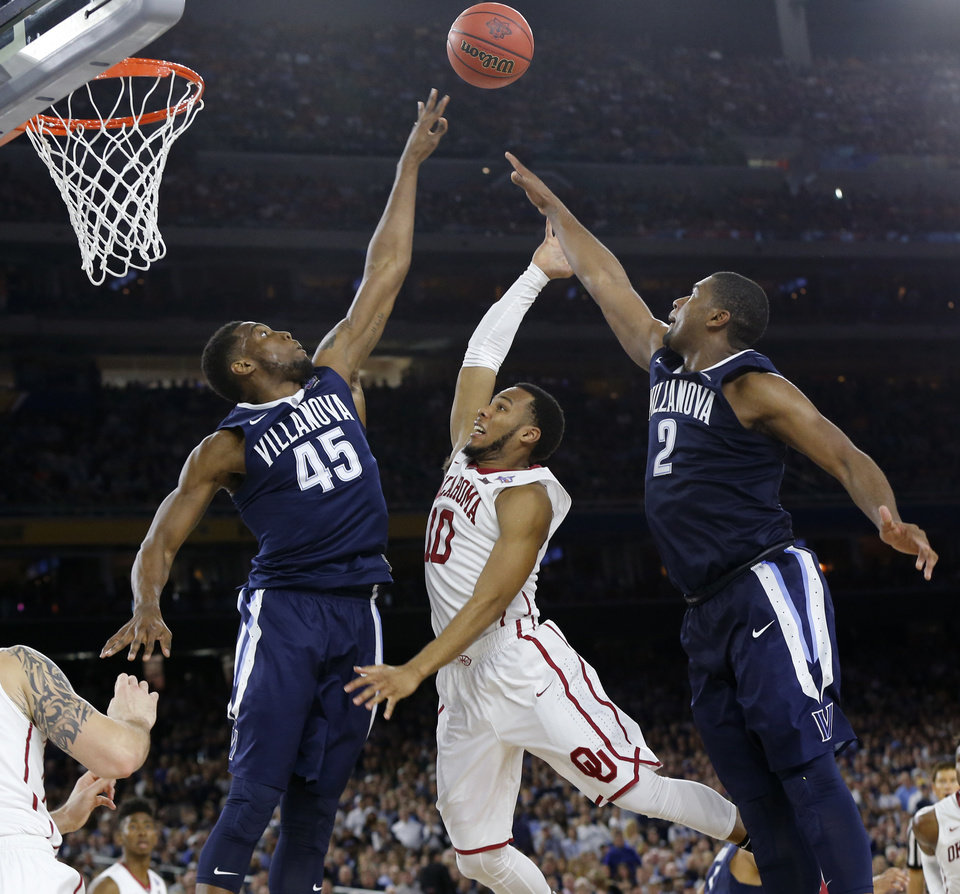 Photo - Oklahoma's Jordan Woodard (10) goes to the basket between Villanova's Darryl Reynolds (45) and Kris Jenkins (2) during the national semifinal between the Oklahoma Sooners (OU) and the Villanova Wildcats in the Final Four of the NCAA Men's Basketball Championship at NRG Stadium in Houston, Saturday, April 2, 2016. Photo by Nate Billings, The Oklahoman