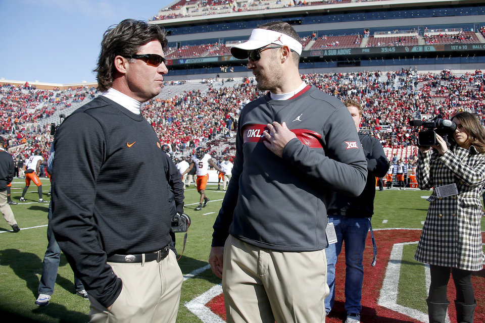 Photo - Oklahoma State coach Mike Gundy, left, and Oklahoma coach Lincoln Riley talk before a Bedlam college football game between the University of Oklahoma Sooners (OU) and the Oklahoma State University Cowboys (OSU) at Gaylord Family-Oklahoma Memorial Stadium in Norman, Okla., Nov. 10, 2018.  Photo by Bryan Terry, The Oklahoman