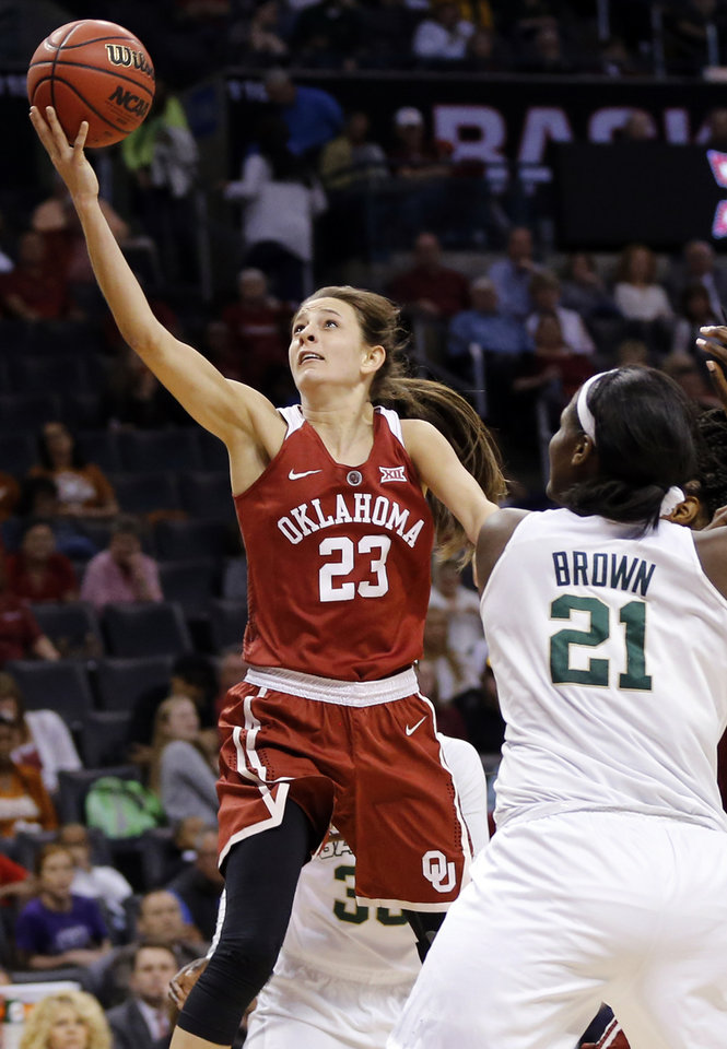 Photo - Oklahoma's Maddie Manning (23) shoots in front of Baylor's Kalani Brown (21) during a semifinal game in the Big 12 Women's Basketball Championship between the Oklahoma Sooners (OU) and the Baylor Lady Bears at Chesapeake Energy Arena in Oklahoma City, Sunday, March 6, 2016. Baylor won 84-57. Photo by Nate Billings, The Oklahoman