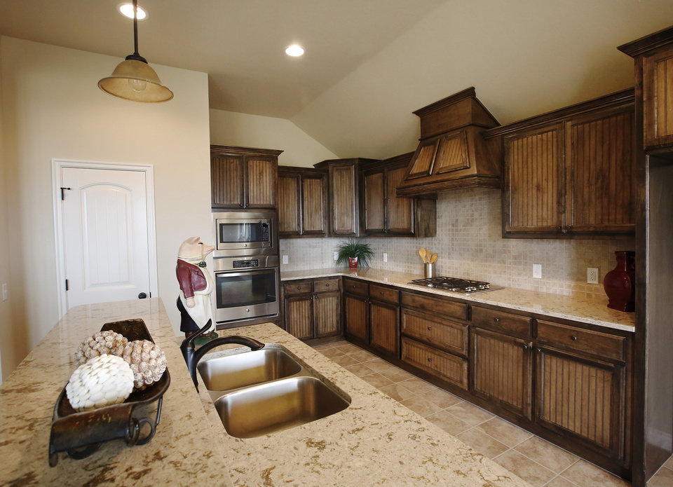 Ideal homes creates two plans for multigenerational for Multigenerational house plans with two kitchens