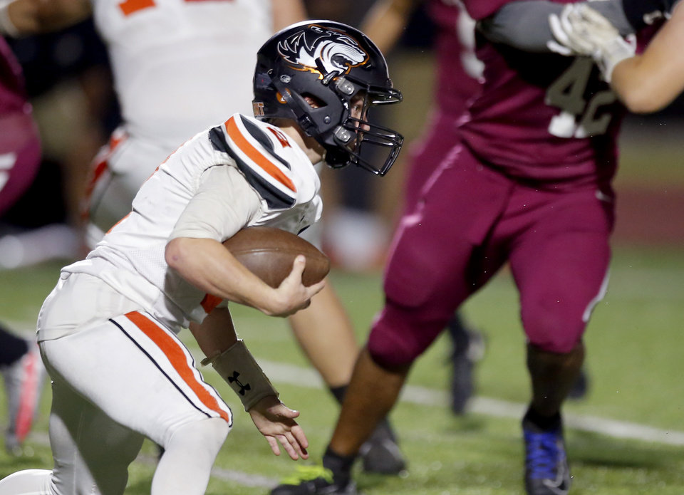 Photo - Crescent's Hunter Wilmoth rushes during the high school football game between Crescent and Oklahoma Christian Academy at Edmond North High School in Edmond, Okla., Thursday, Oct. 22, 2020. Photo by Sarah Phipps, The Oklahoman