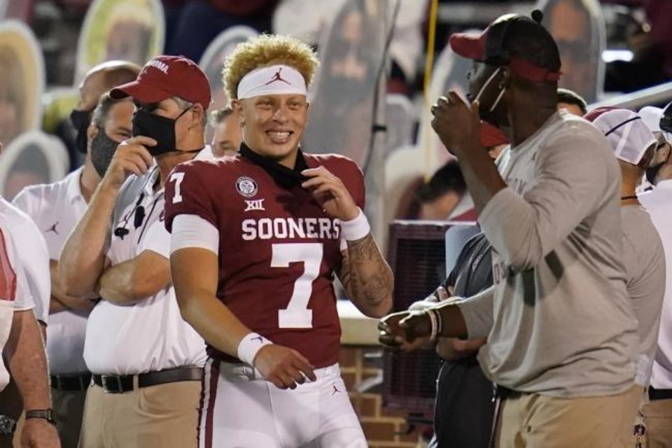 Photo -  Oklahoma quarterback Spencer Rattler (7) smiles on the sidelines during the second half of the team's NCAA college football game against Missouri State on Saturday, Sept. 12, 2020, in Norman, Okla. (AP Photo/Sue Ogrocki, Pool)