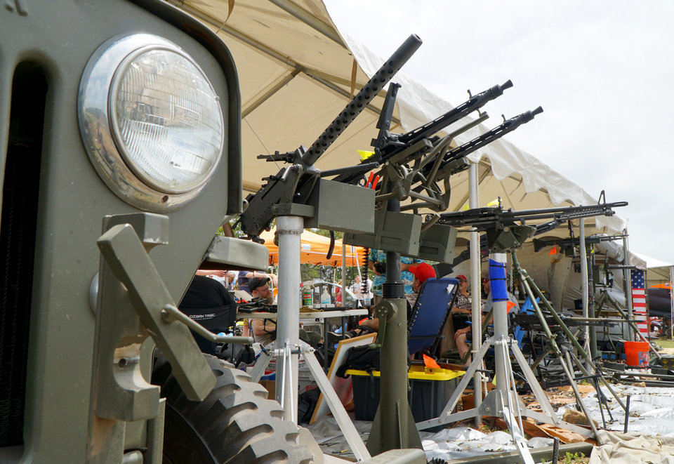 Photo - A line of machine guns is shown to the right of a World War II-era military JEEP Saturday at the Oklahoma Full Auto Shoot and Trade Show in Wyandotte. [Jordan Green/The Oklahoman]