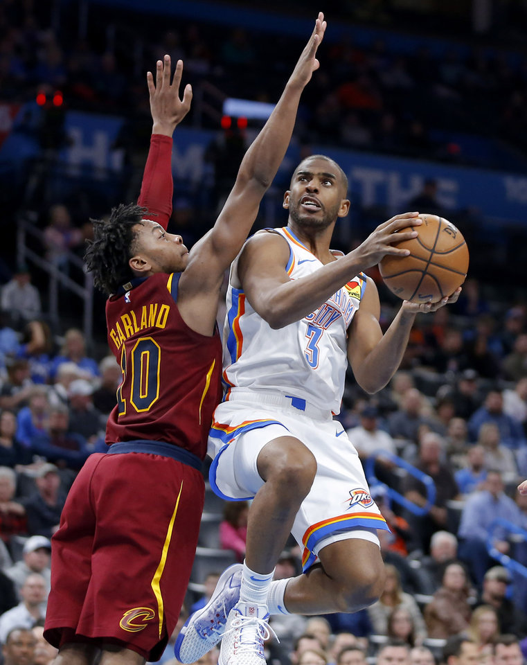 Photo - Oklahoma City's Chris Paul (3) goes to the basket beside Cleveland's Darius Garland (10) during an NBA basketball game between the Oklahoma City Thunder and the Cleveland Cavaliers at Chesapeake Energy Arena in Oklahoma City, Wednesday, Feb. 5, 2020. Oklahoma City won 109-103. [Bryan Terry/The Oklahoman]