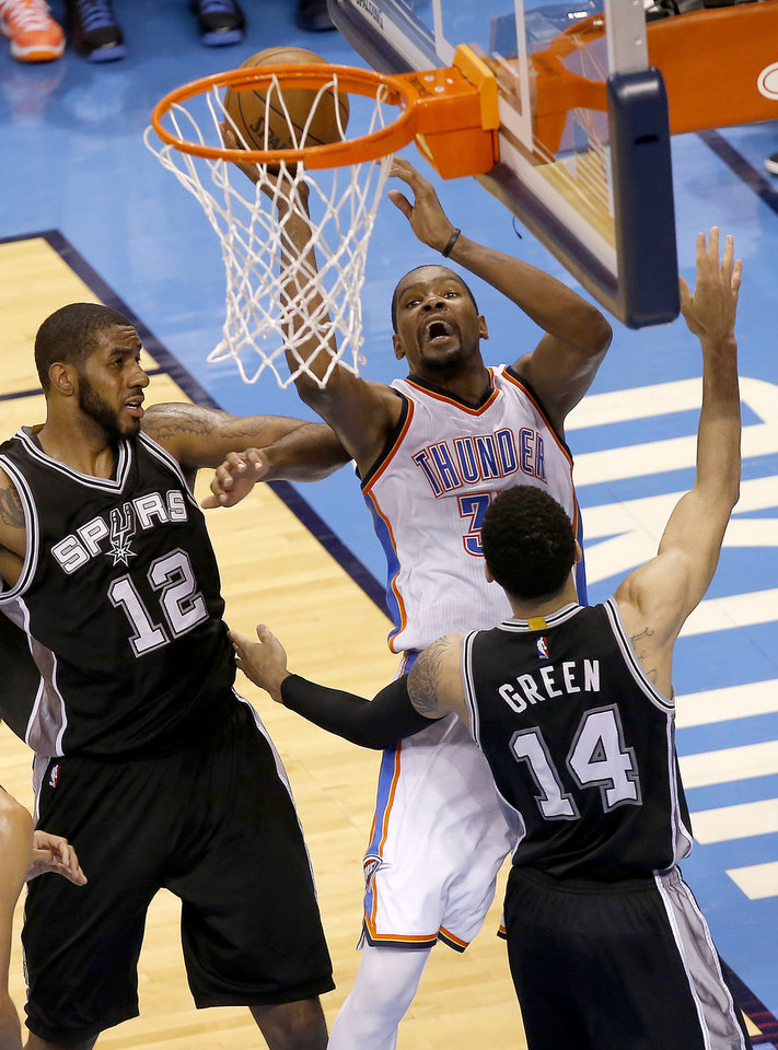 Photo - Oklahoma City's Kevin Durant (35) shoots a basket as San Antonio's LaMarcus Aldridge (12) and Danny Green (14) defend during Game 4 of the Western Conference semifinals between the Oklahoma City Thunder and the San Antonio Spurs in the NBA playoffs at Chesapeake Energy Arena in Oklahoma City, Sunday, May 8, 2016. Photo by Sarah Phipps, The Oklahoman
