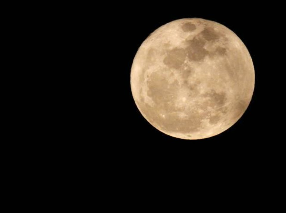 Photo - A full moon is seen in Oklahoma City on March 19, 2011. Photo by Bryan Terry, The Oklahoman