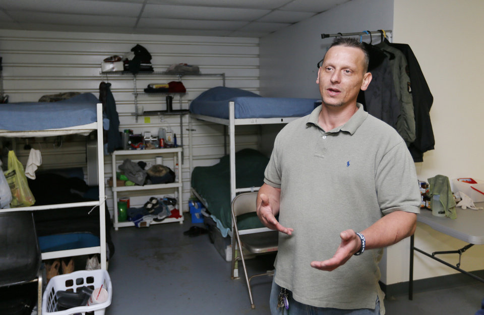 Photo -  Michael Wright, an assistant to Ray Welch, talks in the men's area about Ray's House and Choices Church in Muskogee. [Photo by Nate Billings, The Oklahoman]