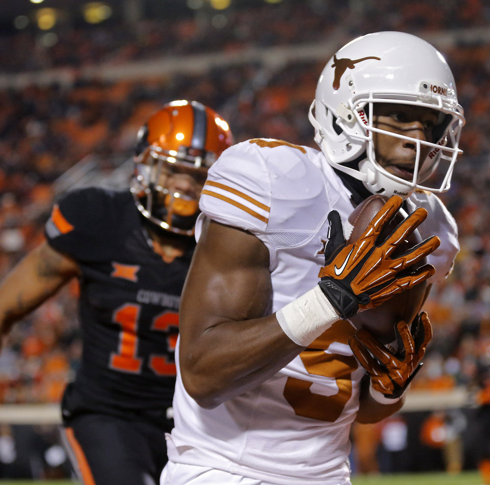Photo - Texas' John Harris (9) makes a touchdown catch in front of Oklahoma State's Jordan Sterns (13) during the college football game between the Oklahoma State University Cowboys (OSU) the University of Texas Longhorns (UT) at Boone Pickens Staduim in Stillwater, Okla. on Saturday, Nov. 15, 2014.  Photo by Chris Landsberger, The Oklahoman