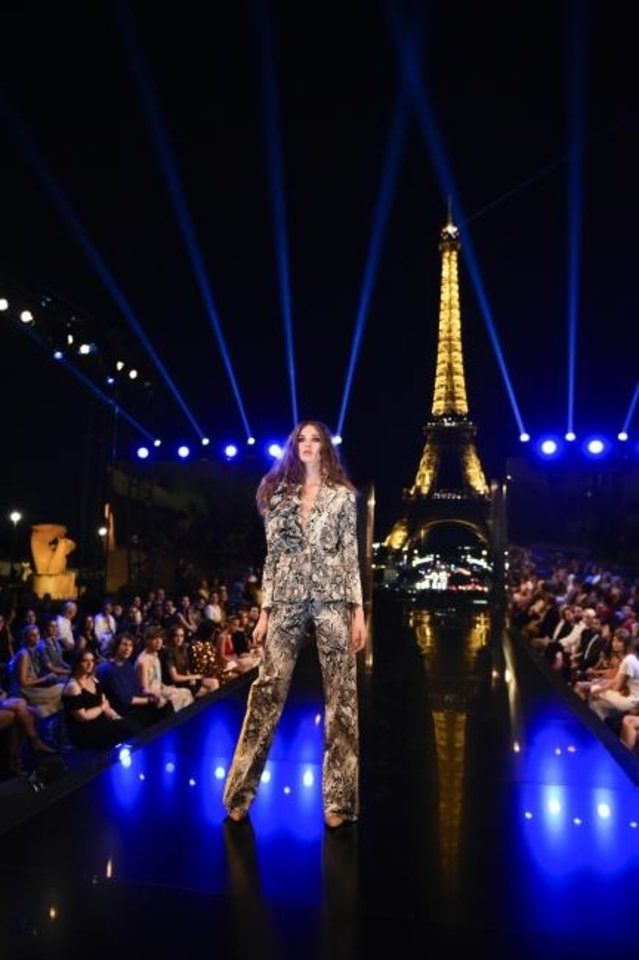 Photo -  A model walks the runway in Paris in the hotly anticipated new Amazon Original series