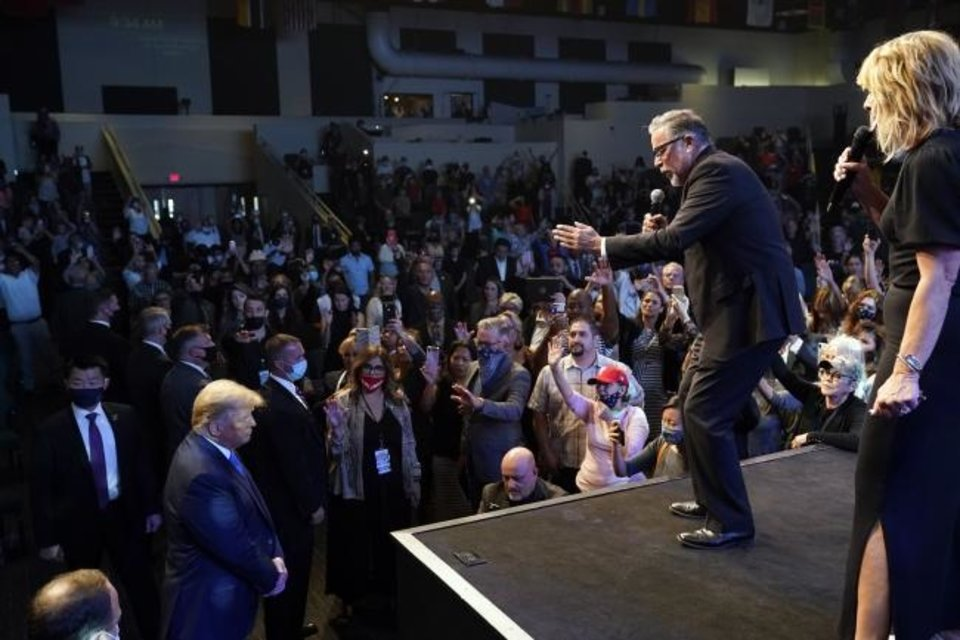 Photo -  President Donald Trump, lower left, attends church Oct. 18 at International Church of Las Vegas, as Pastor Pasqual Urrabazo, second from the right, gestures on stage in Las Vegas. [AP Photo/Alex Brandon/File]