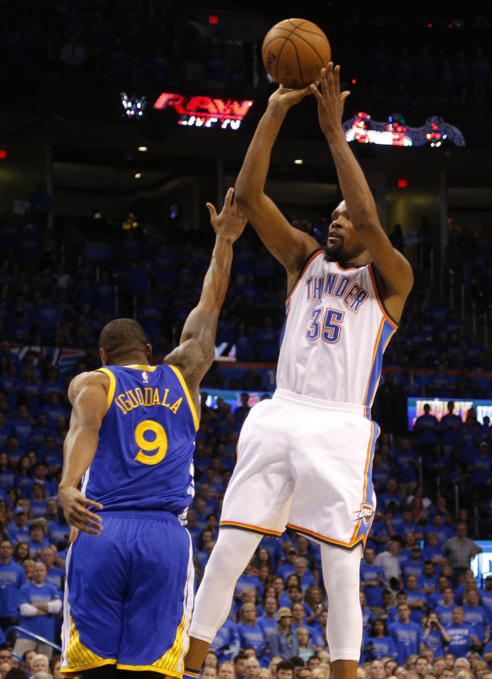 Photo - Oklahoma City's Kevin Durant (35) shoots over Golden State's Andre Iguodala (9) during Game 6 of the Western Conference finals in the NBA playoffs between the Oklahoma City Thunder and the Golden State Warriors at Chesapeake Energy Arena in Oklahoma City, Saturday, May 28, 2016. Photo by Sarah Phipps, The Oklahoman
