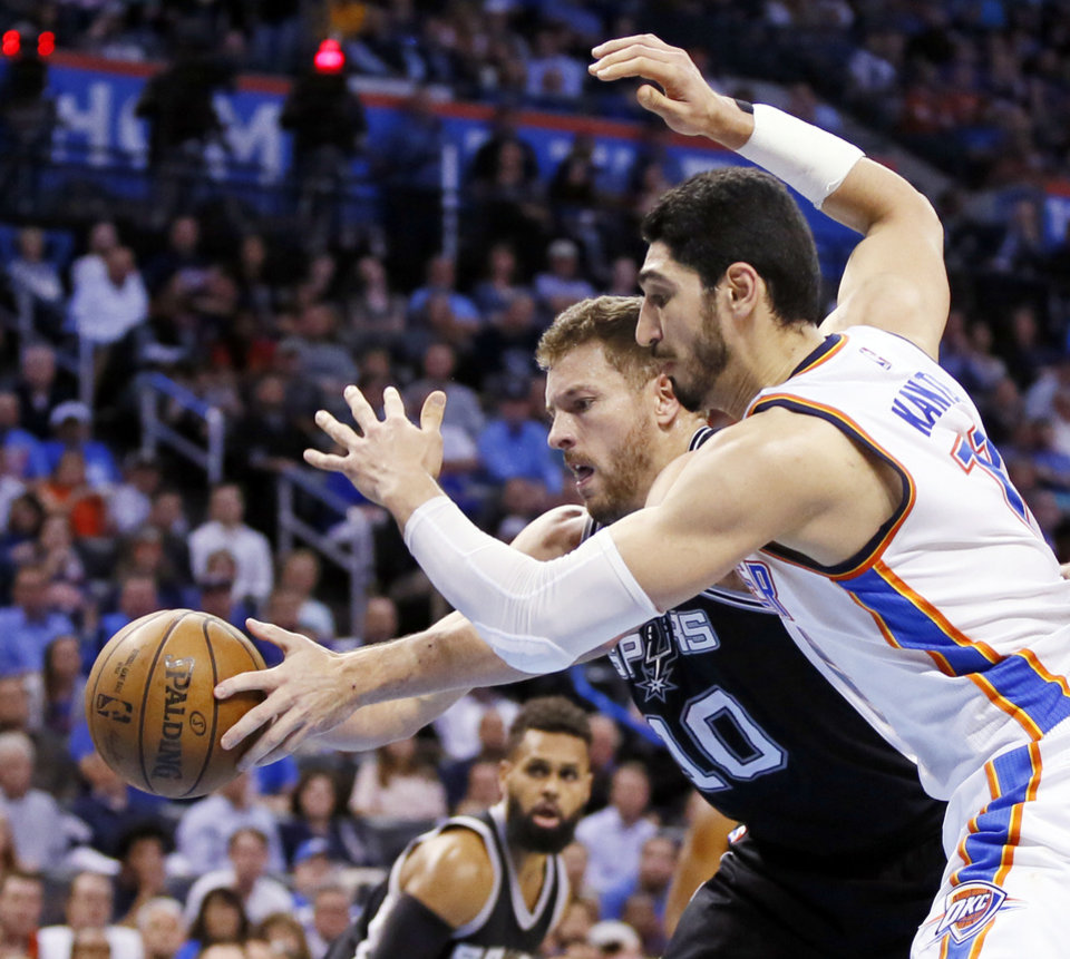 Photo - San Antonio's David Lee (10) and Oklahoma City's Enes Kanter (11) battle for the ball during an NBA basketball game between the Oklahoma City Thunder and San Antonio Spurs at Chesapeake Energy Arena in Oklahoma City, Friday, March 31, 2017. San Antonio won 100-95. Photo by Nate Billings, The Oklahoman