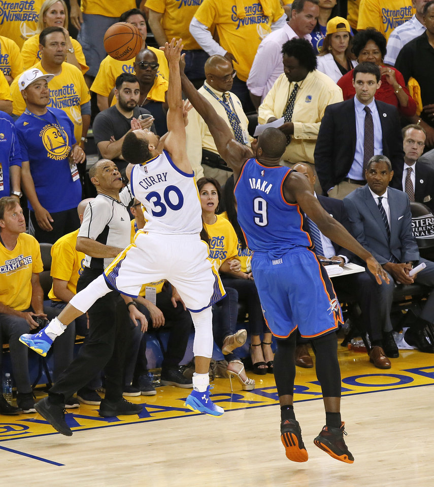 Photo - Oklahoma City's Serge Ibaka (9) fouls Golden State's Stephen Curry (30) on a 3-point shot late in the fourth quarter during Game 7 of the Western Conference finals in the NBA playoffs between the Oklahoma City Thunder and the Golden State Warriors at Oracle Arena in Oakland, Calif., Monday, May 30, 2016. Golden State won 96-88. Photo by Nate Billings, The Oklahoman