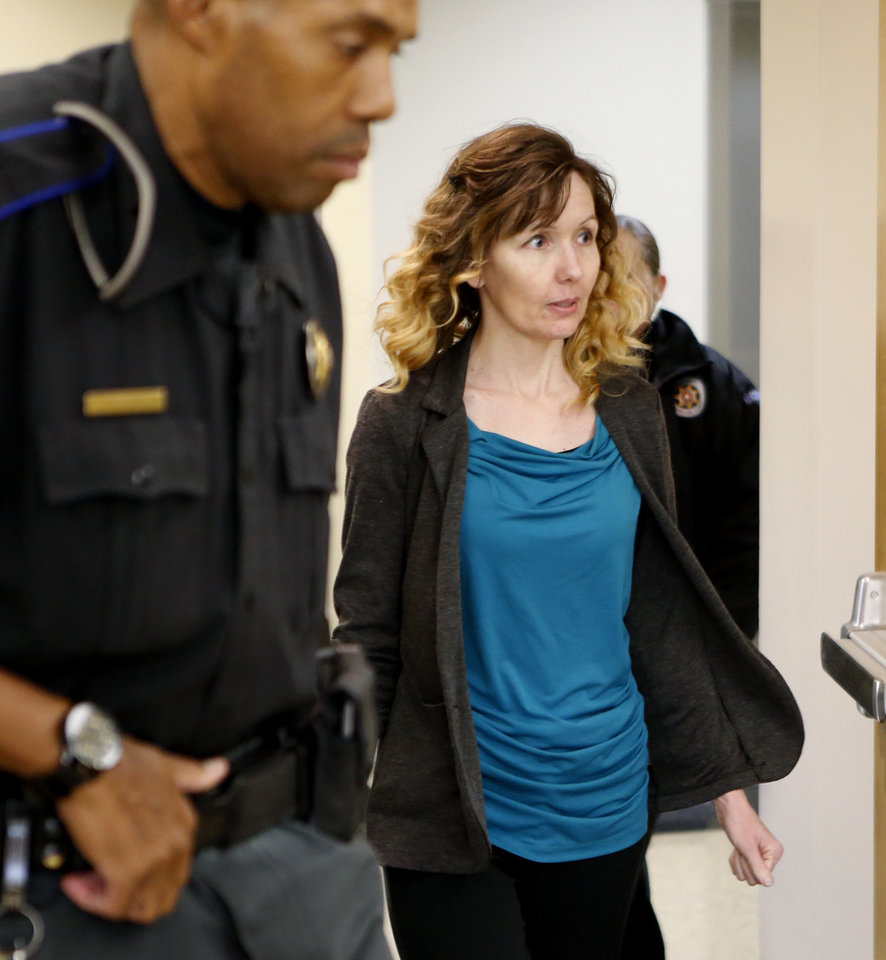 Photo - Melissa Clark enters the courtroom on Thursday, Oct. 26, 2017 in Norman, Okla.  Cleveland County jurors are expected to hear closing arguments in the murder case of Clark, a former home day care owner, charged in the death of a 5-month-old girl left in her care.   Photo by Steve Sisney, The Oklahoman