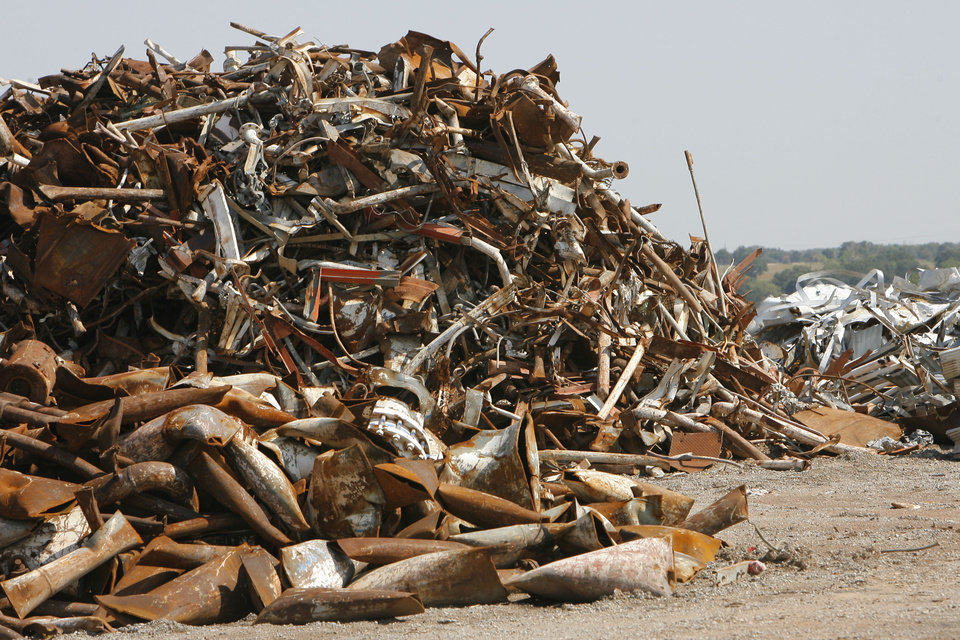 Photo -  Piles of scrap metal from the old refinery await being shipped out as part of the 2006 cleanup process.