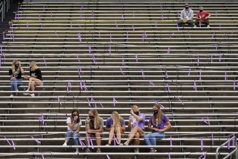 Photo -  Fans are socially distanced as they watch the second half of Kansas State's 35-31 loss to Arkansas State on Saturday. [AP Photo/Charlie Riedel]