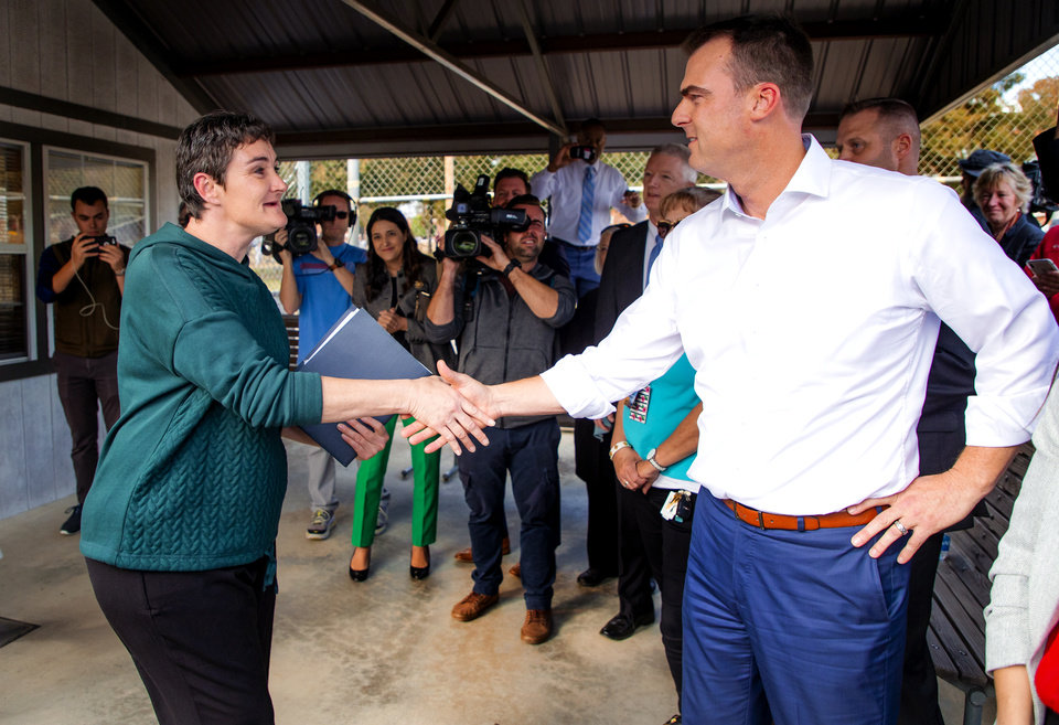 Photo - Stephenie Jeffreys shakes hands with Gov. Kevin Stitt as she is released from the Dr. Eddie Warrior Correctional Facility on Monday, Nov. 4, 2019 in Taft, Okla. Governor Kevin Stitt greeted an estimated 70 women whose sentences he commuted from the facility. [Chris Landsberger/The Oklahoman]