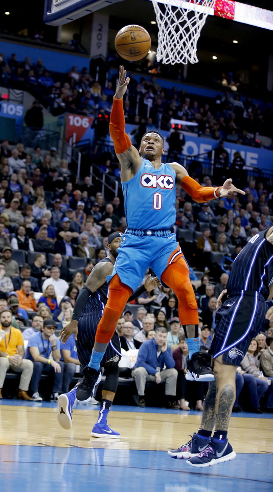 Photo - Oklahoma City's Russell Westbrook (0) goes up for a basket during the NBA game between the Oklahoma City Thunder and the Orlando Magic at the Chesapeake Energy Arena  Tuesday, Feb. 5, 2019. Photo by Sarah Phipps, The Oklahoman