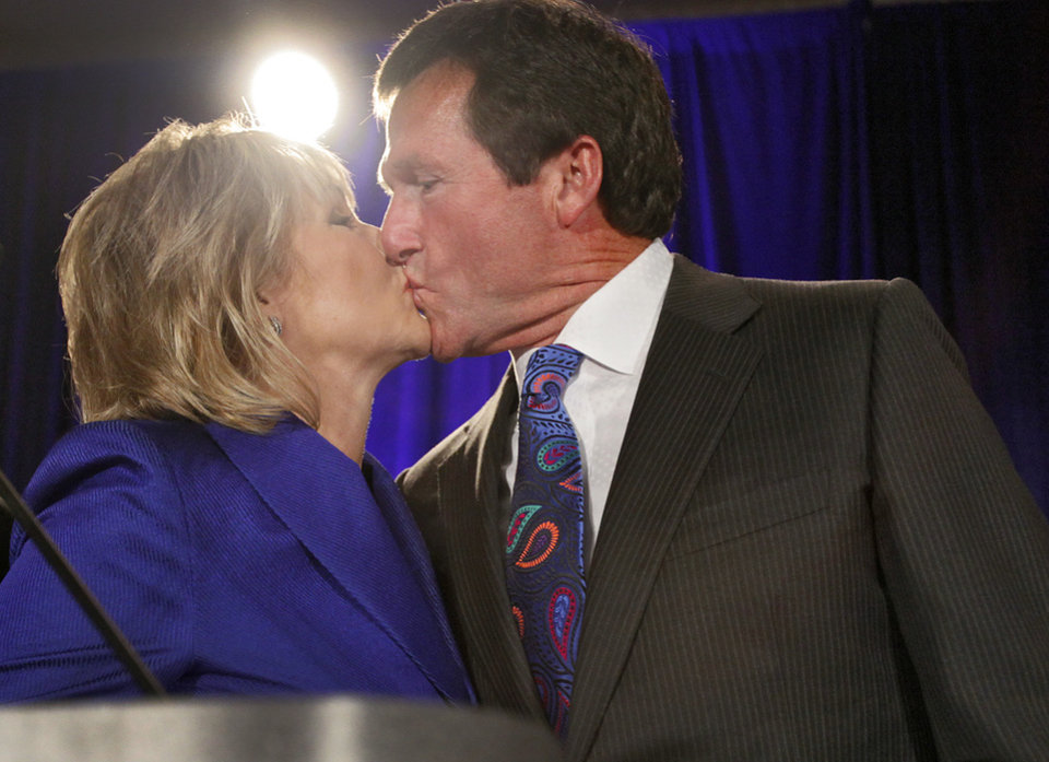 Photo - Mary Fallin receives a kiss from her husband Wade Christensen at the republican Watch Party at the Marriott on Tuesday, Nov. 2, 2010, in Oklahoma City, Okla.   Photo by Chris Landsberger, The Oklahoman