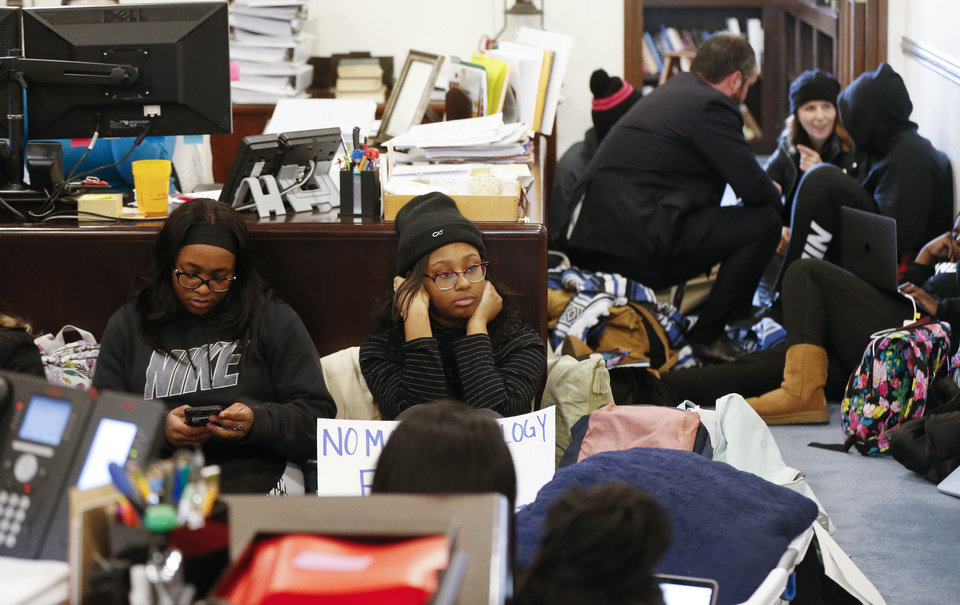 Photo - OU students and others participate in a sit-in organized by the Black Emergency Response Team student group outside of the office of OU provost Kyle Harper in Evans Hall at the University of Oklahoma in Norman, Okla., Wednesday, Feb. 26, 2020. The protest comes after two incidents where faculty members used a racial slur while teaching. [Nate Billings/The Oklahoman]