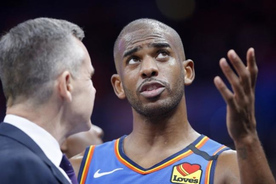 Photo -  Chris Paul (right) and the Thunder are likely heading to Orlando, Fla., to play the final eight games of the regular season starting in late July before the NBA playoffs begin. [Bryan Terry/The Oklahoman]