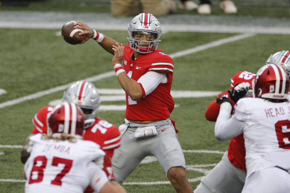 Photo - Ohio State quarterback Justin Fields throws a pass against Indiana during the first half of an NCAA college football game Saturday, Nov. 21, 2020, in Columbus, Ohio. (AP Photo/Jay LaPrete)