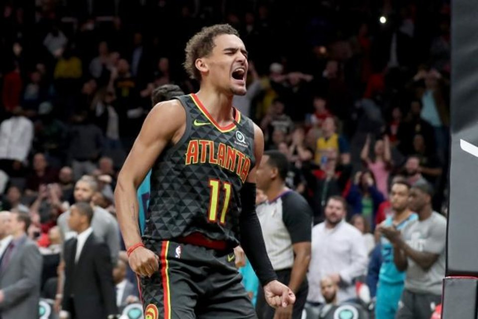 Photo -  Mar 9, 2020; Atlanta, Georgia, USA; Atlanta Hawks guard Trae Young (11) reacts after almost making a basket in the closing seconds of the first overtime against the Charlotte Hornets at State Farm Arena. Mandatory Credit: Jason Getz-USA TODAY Sports