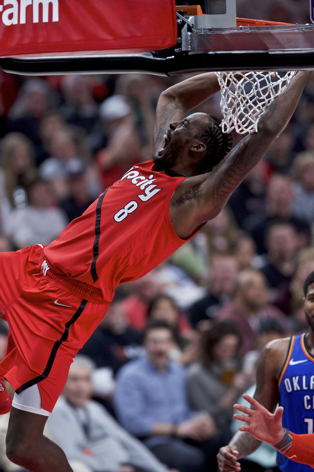 Photo - Portland Trail Blazers forward Al-Farouq Aminu dunks against the Oklahoma City Thunder during the second half of an NBA basketball game in Portland, Ore., Friday, Jan. 4, 2019. (AP Photo/Craig Mitchelldyer)