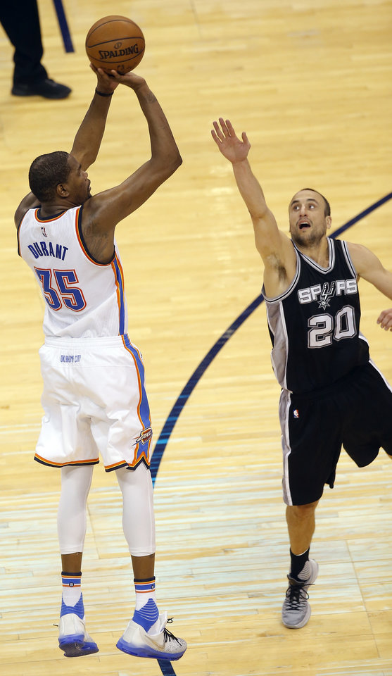 Photo - Oklahoma City's Kevin Durant (35) shoots over San Antonio's Manu Ginobili (20) during Game 4 of the Western Conference semifinals between the Oklahoma City Thunder and the San Antonio Spurs in the NBA playoffs at Chesapeake Energy Arena in Oklahoma City, Sunday, May 8, 2016. Photo by Sarah Phipps, The Oklahoman