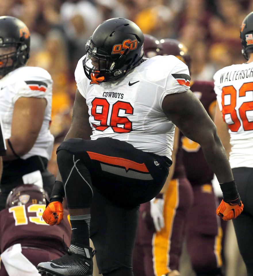 Photo - Oklahoma State's Vincent Taylor (96) celebrates a sack during the college football game between the Central Michigan Chippewas and the Oklahoma State University Cowboys at the Kelly-Shorts Stadium in Mount Pleasant, Mich., Thursday, Sept. 3, 2015. Photo by Sarah Phipps, The Oklahoman
