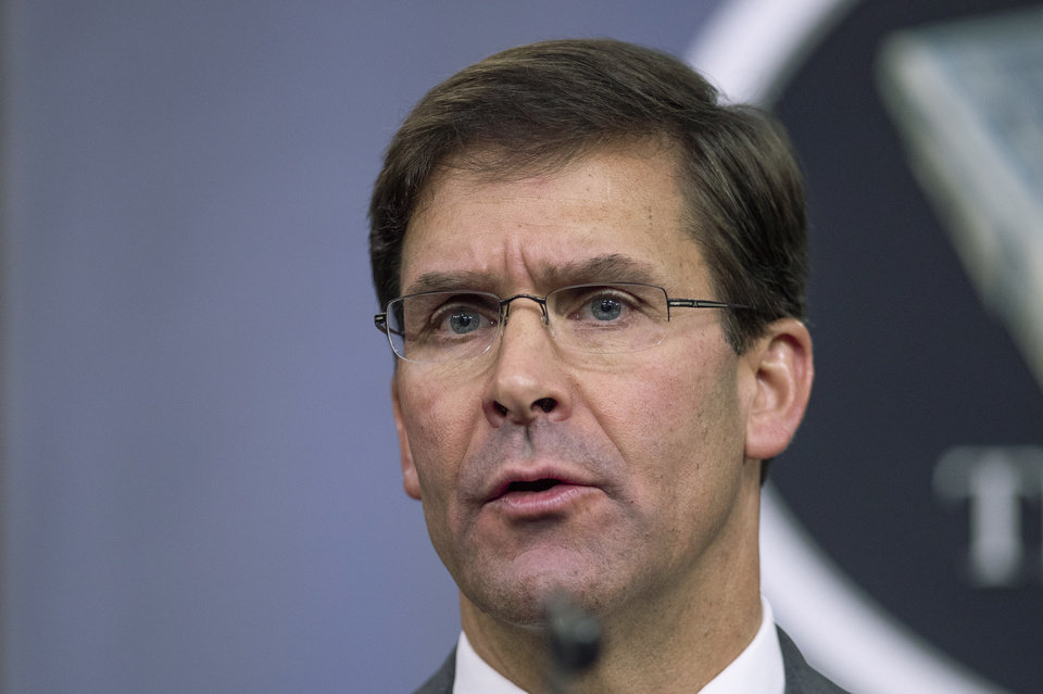 Photo -  FILE - In this Aug. 28, 2019, file photo, Secretary of Defense Mark Esper speaks to reporters during a briefing at the Pentagon. Esper says the