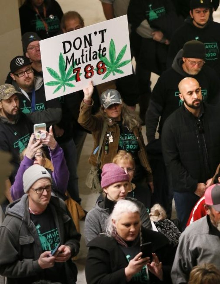Photo -  People listen to a speaker during March the Capitol 2020 on the second floor of the state Capitol in Oklahoma City, Thursday, Feb. 6, 2020. The rally was to protest many of the bills filed in the legislative session that would affect medical marijuana patients and businesses. [Nate Billings/The Oklahoman]