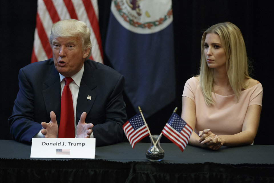 Photo - Ivanka Trump listens at right as her father, Republican presidential candidate Donald Trump, speaks during a roundtable discussion with spouses of military service members, Tuesday, Sept. 6, 2016, in Virginia Beach, Va. (AP Photo/Evan Vucci)