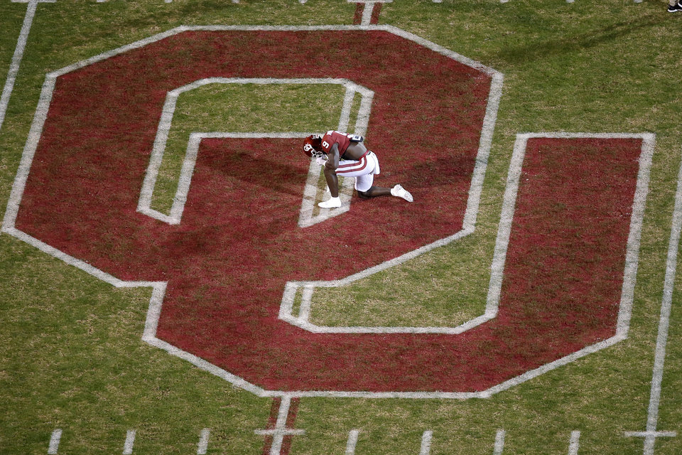 Photo - Oklahoma's Kenneth Murray (9) kneels before an NCAA football game between the University of Oklahoma Sooners (OU) and the TCU Horned Frogs at Gaylord Family-Oklahoma Memorial Stadium in Norman, Okla., Saturday, Nov. 23, 2019. Oklahoma won 28-24. [Bryan Terry/The Oklahoman]