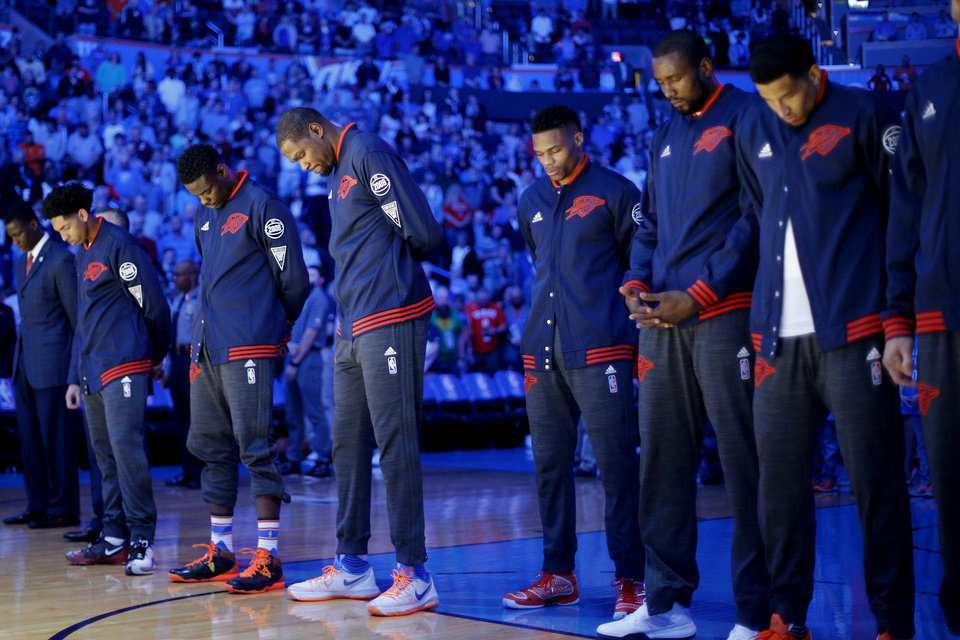 Photo -  Several Oklahoma City Thunder players bow their head as a prayer is given before an NBA basketball game between the Thunder and the Houston Rockets on March 22 at Chesapeake Energy Arena in Oklahoma City. [Photo by Bryan Terry, The Oklahoman]