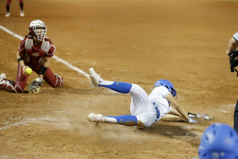 Photo - UCLA's Jacqui Prober (27) scores the game winning run in the second NCAA softball game in the championship series of the Women's College World Series between Oklahoma and UCLA at USA Softball Hall of Fame Stadium in Oklahoma City, Tuesday, June 4, 2019. UCLA won 5-4. [Bryan Terry/The Oklahoman]