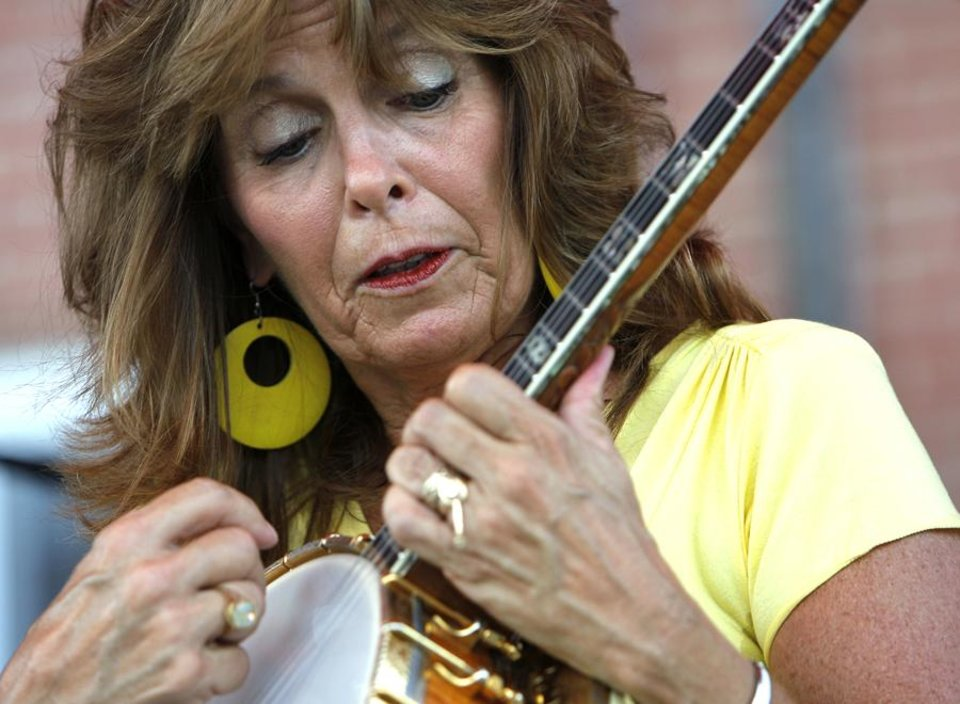 Photo -  Cathy Reilly performs during the Chevy Bricktown Banjo Bash near Sheridan Avenue and Oklahoma Avenue in Oklahoma City, Saturday, July 16, 2011.  The event was part of the annual convention of the Fretted Instrument Guild of America.  Photo by Garett Fisbeck, The Oklahoman