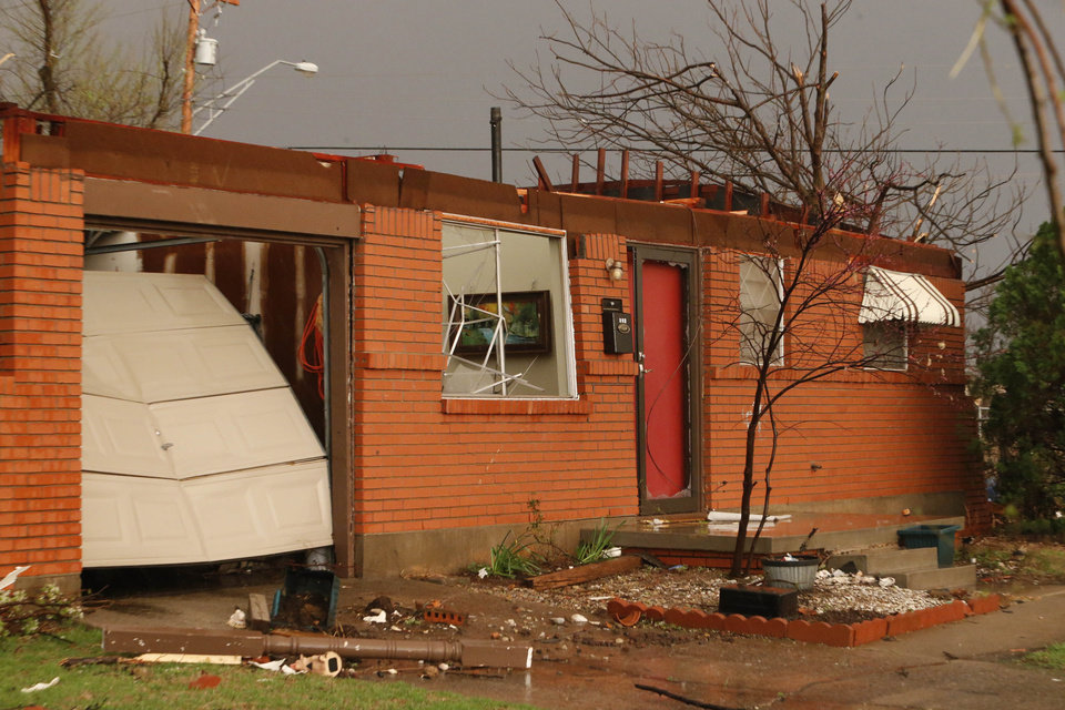 Photo - The roof was blown off this house at SE 4th and Irving by Tornado force winds on Wednesday, March 25, 2015 in Moore, Okla. Photo by Steve Sisney, The Oklahoman