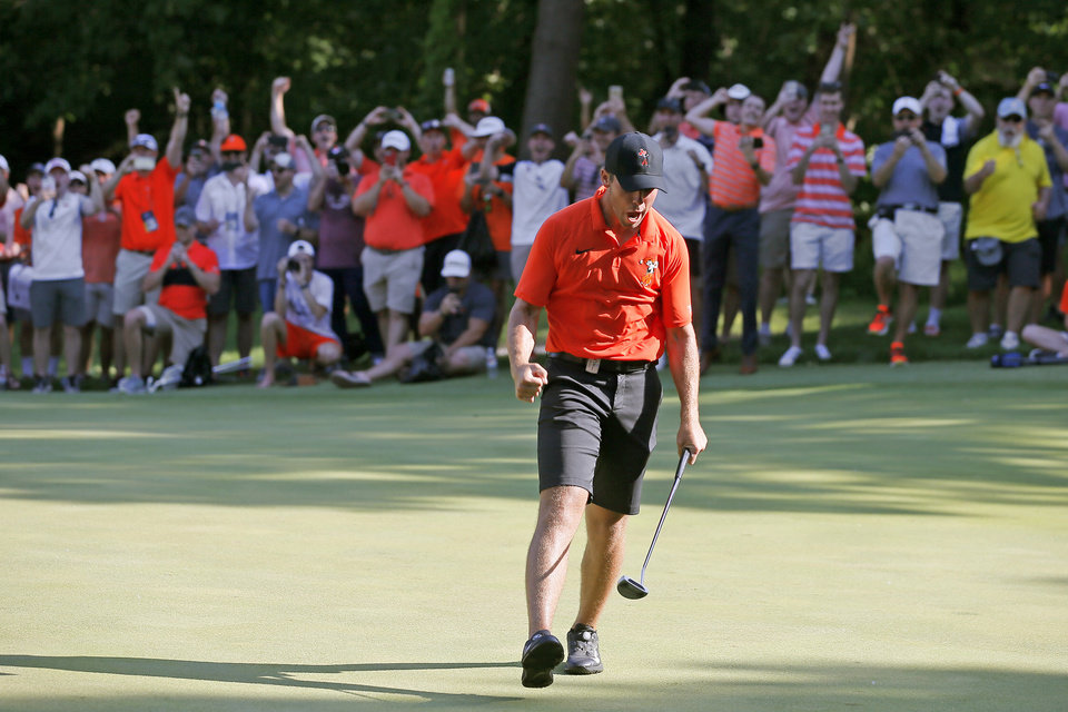 Photo - Oklahoma State's Matthew Wolff celebrates after clinching the victory for OSU on the 15th hole in the final round of the 2018 NCAA Division I Men's Golf Championships at Karsten Creek Golf Club in Stillwater, Okla., Wednesday, May 30, 2018. Photo by Bryan Terry, The Oklahoman