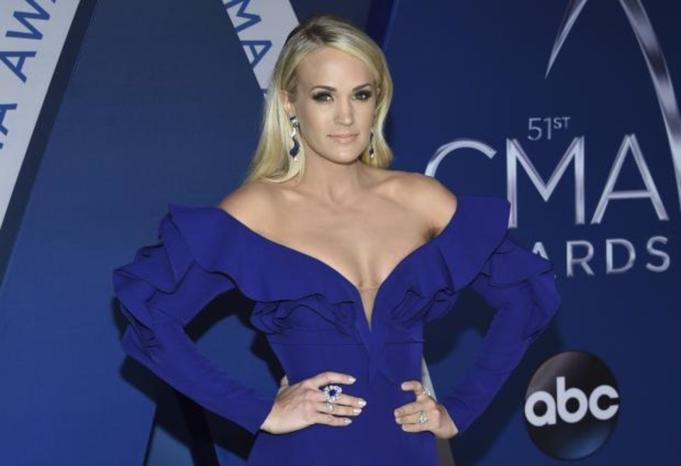 Photo - Carrie Underwood arrives at the 51st annual CMA Awards on Wednesday, Nov. 8, 2017, in Nashville, Tenn. AP file photo