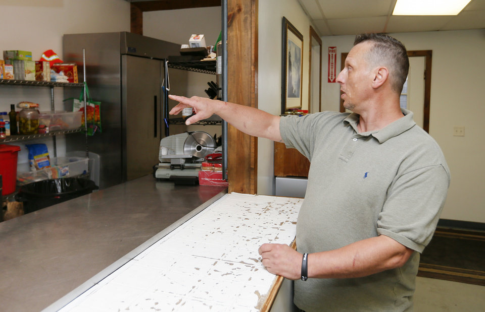 Photo -  Michael Wright, an assistant to Ray Welch, talks about the kitchen at Ray's House rehab facility and Choices Church in Muskogee. [Photo by Nate Billings, The Oklahoman]