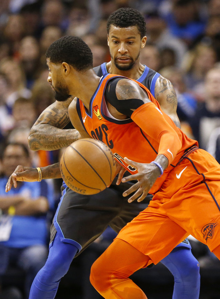 Photo - Oklahoma City's Paul George (13) drives against Dallas' Trey Burke (23) in the fourth quarter during an NBA basketball game between the Dallas Mavericks and the Oklahoma City Thunder at Chesapeake Energy Arena in Oklahoma City, Sunday, March 31, 2019. Dallas won 106-103. Photo by Nate Billings, The Oklahoman