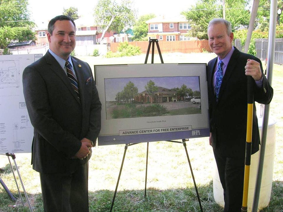 Photo - Michael C. Carnuccio, president of the Oklahoma Council of Public Affairs, Inc., left, stands with a rendering of the Advance Center for Free Enterprise with Oklahoma City Mayor Mick Cornett. The $3.5 million project is scheduled to be complete next April. A groundbreaking was held Thursday near the OCPA at 14th and North Lincoln.