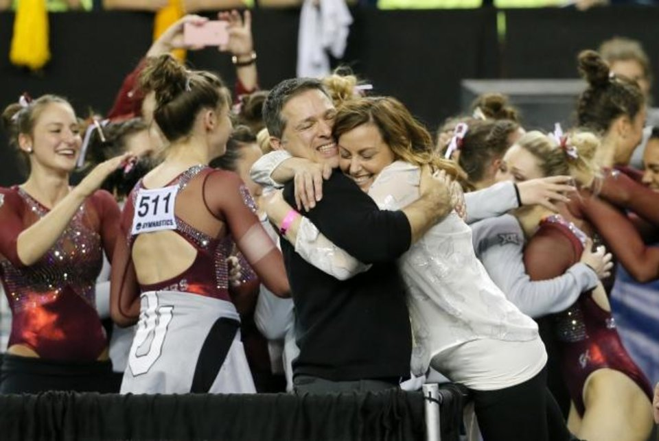 Photo -  OU assistant coach Lou Ball, center left, and head coach K.J. Kindler, center right, celebrate with their team after winning the NCAA women's gymnastics title on April 16, 2016, in Fort Worth, Texas. [AP Photo/Tony Gutierrez]