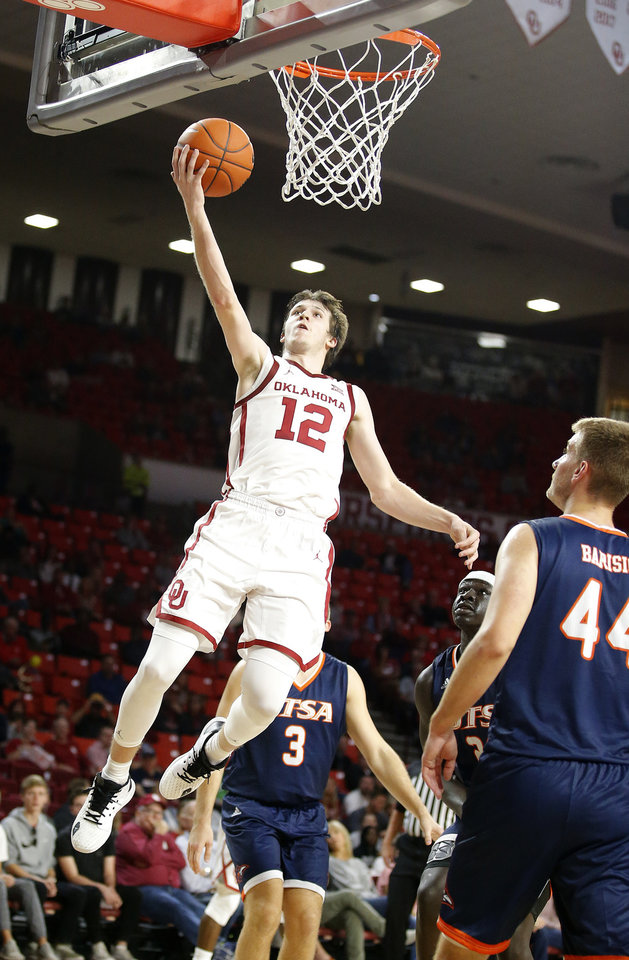 Photo - Oklahoma's Austin Reaves (12) goes up for a lay up during the college basketball game between the University of Oklahoma and the UTSA Roadrunners at the Lloyd Noble Center in Norman, Okla.,  Tuesday, Nov. 5, 2019.  [Sarah Phipps/The Oklahoman]