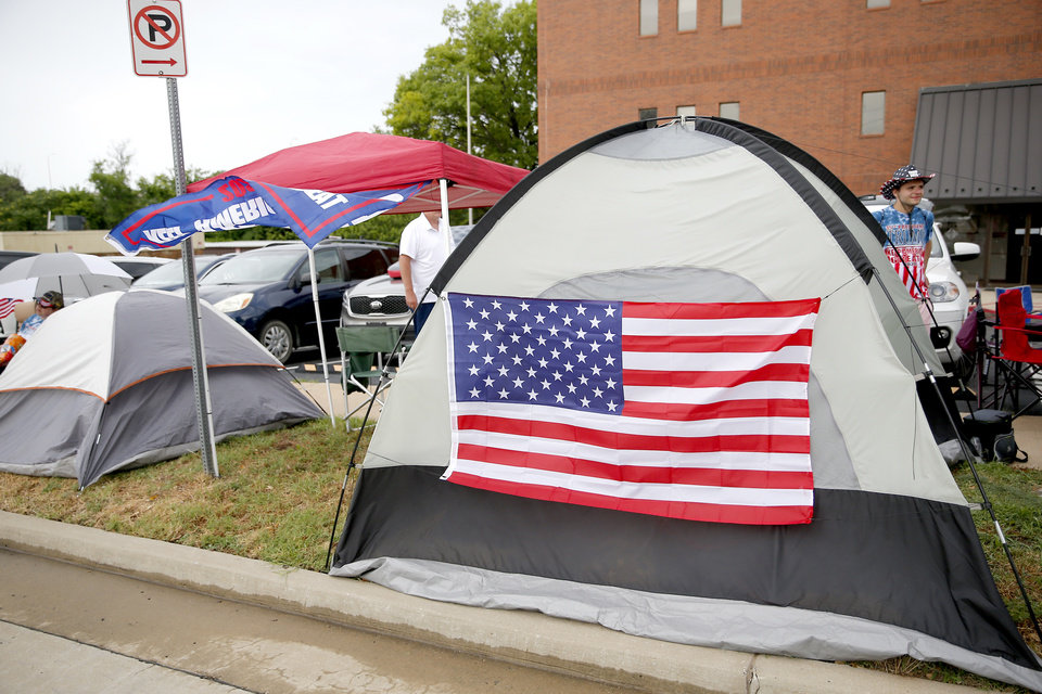 Photo - Tents line the streets with Trump supporters in downtown Tulsa, Okla., ahead of President Donald Trump's Saturday campaign rally, Friday, June 19, 2020. [Sarah Phipps/The Oklahoman]